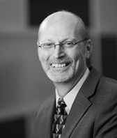 black and white headshot of Dan Martin, Leadership Team, Added Value Services at Intereum