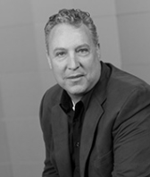 black and white headshot of Scott Jamison, Vice President of Operations at Intereum