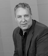 black and white headshot of Scott Jamison, Vice President of Operations at Intereum