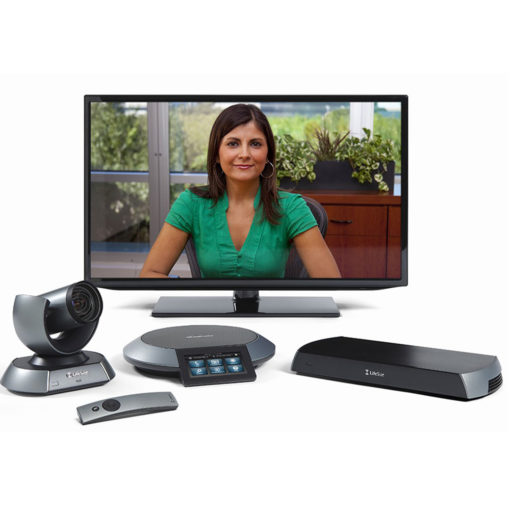 computer monitor with image of woman in green for video conference and various electronic devices for call