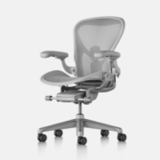 Aeron rolling office chair from Herman Miller with light gray mesh back and silver arms and legs