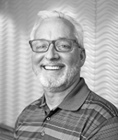 black and white headshot of John Podergois, Leadership Team, Operational Services at Intereum