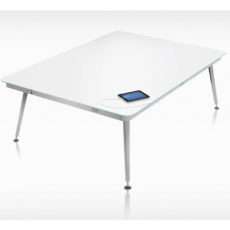 white top square table with four silver chrome tube legs and tablet plugged in, in white stark room Thumbnail